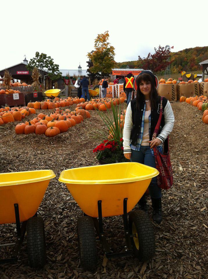 Surrounded by pumpkins during a typical Canadian fall