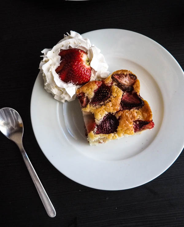 Dairy-Free Strawberry cake on a plate with a spoon